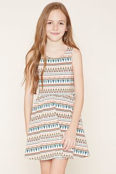 Forever 21 Girls - A sleeveless knit dress with an allover mixed geo print and a shirred waist.