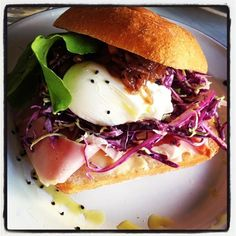 Poached egg roll with pasture raised ham, fennel and brussel slaw, garlic aioli and choke chutney.