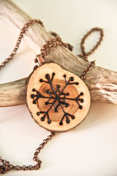 Snowflake Wood Burned Art Necklace OOAK. $24.00, via Etsy.
