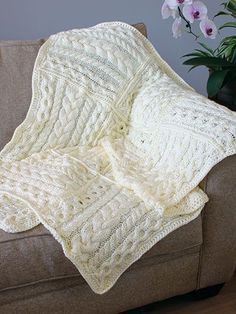 Free knitting pattern for Cabled Cubed Throw - A beautiful way to practice your cables is this pieced blanket of 5 different cable patterns in squares. See more cable afghan patterns at http://intheloopknitting.com/cable-afghan-knitting-patterns/  (affiliate link)