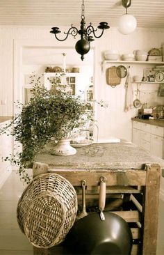 This French country kitchen is so chic. Love the basket & pans hanging from the butchers block.
