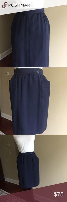 Vintage Saint Laurent Rive Gauche Navy Skirt Front button and zipper on this EUC vintage Saint Laurent Rive Gauche skirt. Navy 100% light weight wool.  USA size 4 Saint Laurent Skirts Pencil