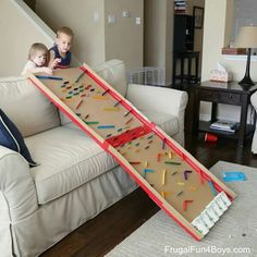 Take a giant piece of cardboard and attached some objects to create a giant plenko table/obstacle coarse for marble play for the kids.