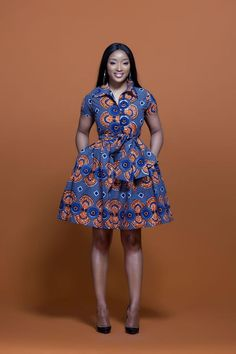 Shop Grass-fields African Print Fashion - African Print Murielle Midi Dress to look effortlessly cool. It's bold and beautiful, perfect for any social occasion! Short African Dresses, Ankara Short Gown Styles, Kente Styles, Latest African Fashion Dresses, African Print Dresses, African Print Fashion, Africa Fashion, African Prints, Men's Fashion