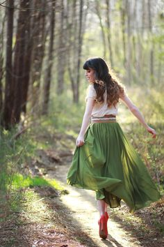 White, green, and coral red. Long skirts. Wide belts. Running through forests.