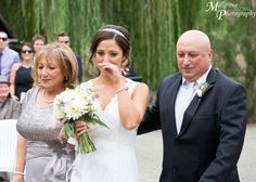An emotional bride walking down the aisle - wedding at Inglewood Estate