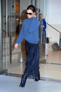 She wore a navy wool skirt teamed with a knitted roll-neck jumper out in New York.