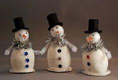 Little Standing Snowman -Make a bunch of these little guys and place one of your mantel, on your counter, on your desk - wherever! Snowman Christmas crafts are a fun and cute way to celebrate the season. #tutorial