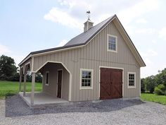 pole barn garage Keystone Barns: Supplier of Horse Barns, Equine Sheds & Door Hardware Pole Barn Garage, Building A Pole Barn, Metal Shop Building, Pole Barn House Plans, Pole Barn Homes, Barn Plans, Storage Building Homes, Cabana, Shed Door Hardware