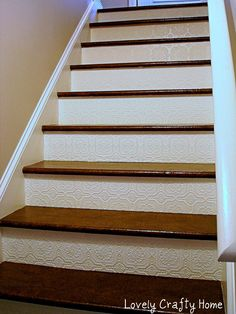 Textured Wallpaper for stair risers. Also check out their paper bag flooring!
