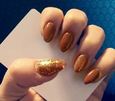 Brown glitter by nails art.
