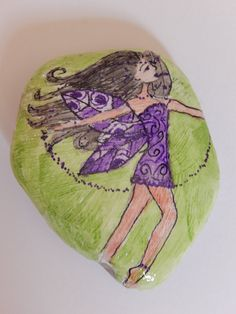 Dancing Spring time Fairy.  Hand painted Stone