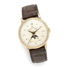 Omega. An 18K gold manual wind triple calendar wristwatch with moon phase Ref:2473, Case No.10803706, Movement No.10937336, Circa 1944