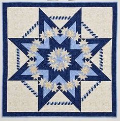 """Blue and white quilt from the book """"Star Struck Quilts"""" by Barbara Cline; some of the most unusual star quilts we've seen.  note also the twisted ribbon that connects the points of the star.  Photos and interview by Jackie."""