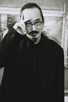 Satoshi Kon - more info: http://en.wikipedia.org/wiki/Satoshi_Kon