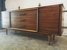 Fully restored walnut lowboy  Simple classic design accented by heavy elm center trim.  #ferrousfurnishings #vintage #moderndesign #moderndecor #mcm #midcentury #interiordesign #restoration.
