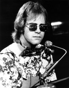 """""""From this day on, I own my father's gun. We dug his shallow grave beneath the sun. I laid his broken body down, beneath the southern land. It wouldn't do to bury him, where any Yankee stands.""""-Elton John"""