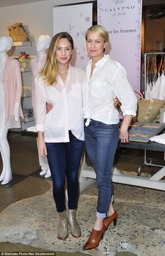 Twins!: Robin Wright, 49, with daughter Dylan Penn, 24, wore almost the same white blouse denim jean outfits at the launch of Pour Les Femmes line at Calypso St. Barth in Brentwood on Saturday