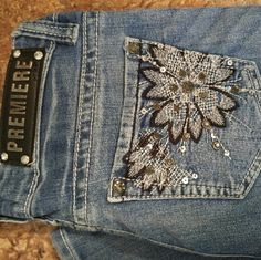 Premiere Jeans Premiere jeans with jeweled flower pockets. Size 5/6, regular length. I bought these jeans from a fellow posher, and unfortunately they are too big. Premiere Jeans
