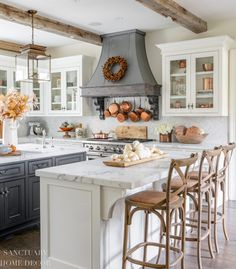 Farmhouse Kitchen Fall Decorating Ideas - Sanctuary Home Decor Farmhouse-Kitchen-Fall-Decorating-Ideas-Marble Countertops-White glass front cabinets-Center island with barstools-Pendant lanterns Farm Kitchen Ideas, Fall Kitchen Decor, Marble Kitchen Ideas, Kitchen Ideas Simple, Marble Island Kitchen, Farm Kitchen Design, Kitchen Images, Kitchen Islands, Kitchen Layout
