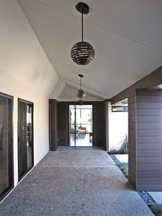 Mid Century Modern Front Doors: Midcentury Entry Basic Back Door Concept Clad The Brick Around The Door And On The Pillar With Wood Pivoting Doors ~ gtrinity.com Design