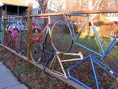 Whimsical fence created from old bike frames, wheels, and lumber... Fun but too complicated for this DIY'er.