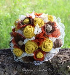 Golden yellow, burnt orange, chocolate brown, and natural tan burlap flowers along with ivory lace complete this rustic, fall bridal bouquet.  This