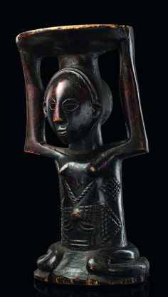 Africa | Caryatid stool from the Luba people of DR Congo | Wood; shiny dark brown patina