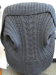 Ravelry: Circular Shrug pattern by Julia Allen. I like this variation for the pattern. Another variation used seed stitch for the main part.