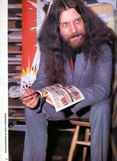 """Alan Moore, an English writer primarily known for his work in comic books, is an occultist and anarchist. Frequently described as the best graphic novel writer in history, he has been called """"one of the most important British writers of the last fifty years.""""[16] Despite his own personal objections, his books have provided the basis for a number of Hollywood films, including From Hell, The League of Extraordinary Gentlemen, V for Vendetta, and Watchmen."""