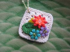 Add some Bling to a plain granny square for some pizzazz! {Garden Cluster Crochet Necklace by Reyney on Etsy, $10.00}