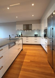 White cupboards, grey top, blackbutt floors by Kitchen Cupboard Colours, White Kitchen Cupboards, Timber Kitchen, Kitchen Flooring, Kitchen Benchtops, Gray Cabinets, Kitchen White, Splashback, Kitchen Backsplash