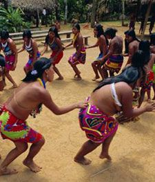 The people of Panama dancing in a circle.