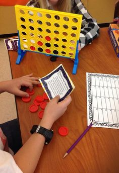 From teaching with a mountain view - use task cards with games, when a student answers the question correctly they may take a turn in a fun game(chutes and ladders, connect 4)