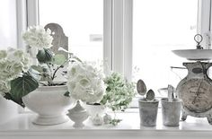 charming scale tucked into this vignette. Old Scales, Kitchen Island Decor, Swedish Style, Simple House, Interior Accessories, Country Chic, White Flowers, Fresh Flowers, Shades Of Grey