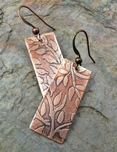 Copper earrings with hand etched leaf design. Perfect for nature lovers...