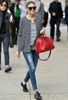 Olivia mixes stripes with stripes combine with the red bag - Awesome!