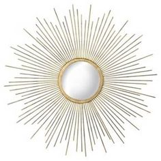 Bring a bright ray of sunshine to any room with this 23-inch sunburst mirror. Made from metal, it features an abundance of rays surrounding a gold-finish round mirror. With its modern retro vibe, this sunburst mirror will create an instant focal point over a mantel, sofa or console. Integrated hooks offer easy installation.