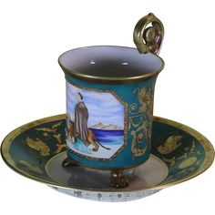 Collectors Cup & Saucers with Painting and Graceful Rosace Handle