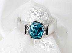 Ladys Blue Topaz, Diamond, 18K White Gold Ring