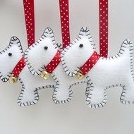 These handsome Westie dog hanging decorations are hand stitched by little old me in a corner of gorgeous Devon, England. Made with felt and lightly stuffed with polyester filling, they each have a red satin ribbon to hang them up wherever you like. Ea...