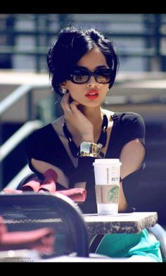 love the dark hair and red lips! wonder how i can get my skin to look that flawless..