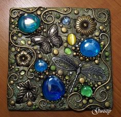 Butterfly Polymer Clay Plaque - Another amazing polymer clay art piece. Looks like metal, not clay. Love the embedded stones. Clay with stones. Maybe as pendants or art pieces, don't know yet. Tile Art, Mosaic Art, Mosaic Glass, Mosaic Tiles, Glass Art, Mosaics, Stained Glass, Mosaic Crafts, Mosaic Projects