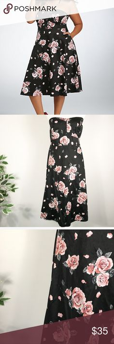 "TORRID 20 plus size Floral Strapless Swing Dress Ready for a night of dancing, this swing dress is a retro style that has the power of the flower! A black sweetheart style that shows some shoulders thanks to the strapless cut, the allover pink rose print gets its flirt on even if you miss a step. Side pockets!!!   Size 20 measures approx  22""b 21""w 28"" hip 37"" long laying flat. Cotton/spandex/polyester torrid Dresses"