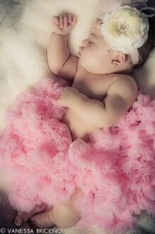 Baby sleeping in pink