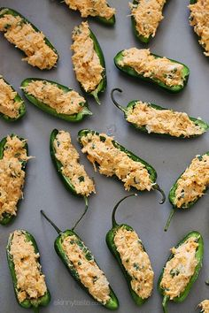 Baked Buffalo Chicken Jalapeño Poppers | Skinnytaste. Awesome recipe, but turns out you shouldn't eat half of them in one sitting.