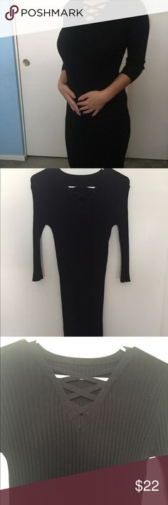 A beautiful black cotton skin tight dress It's a cotton skin tight long sleeve dress. It has crossed lines in the front of the dress. Only wore it a few times. Perfect for a night out during fall. The length goes down to knee. other Other