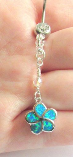 This beaded belly button ring is made with a 14 g rhinestone belly bar, a clear rainbow finish Czech Firepolish bead, and a lab created blue fire opal flower with silver plated jump rings to connect everything.   This navel ring is the perfect addition to any spring or summer outfit, as the beads and the flower are incredibly eye-catching and the rhinestones in the navel bar catch the light for a rainbow of subtle colors!  $14.75  , ,