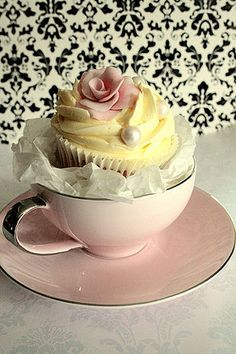 Great idea for small party!  You could purchase several antique tea cups, fill with cupcake and give the cup as a gift!
