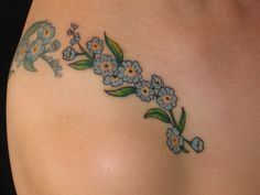 Although I don't really like color tattoos-I would love a forget me not flower by my I love you tattoo